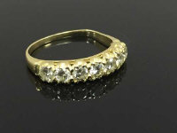 An 18ct gold seven stone diamond half eternity ring, approximately 0.7ct, size N/O.