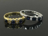 Two diamond and sapphire rings set in yellow and white 18ct gold. (2)
