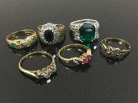 A collection of six dress rings, some set with sapphires, rubies and emeralds. (6)