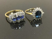 Two 18ct gold sapphire and diamond rings, size P. (2)