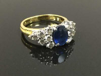 A fine quality 18ct gold sapphire and diamond cluster ring, size M.
