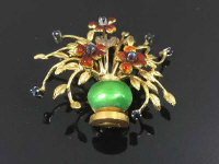 An 18ct gold enamel and sapphire brooch set as a vase of flowers, 8.5g.