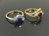 Two 18ct gold diamond, ruby and sapphire rings. (2)
