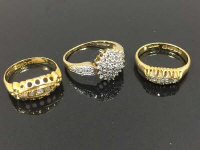 Two 18ct gold five stone diamond rings, together with a 9ct gold cluster ring. (3)