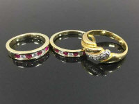 Two gold half eternity rings set with diamonds and rubies, together with an 18ct gold diamond ring. (3)