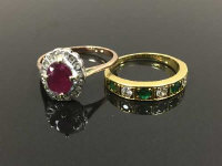A gold ruby and diamond ring, together with an 18ct gold emerald and diamond half eternity ring. (2)