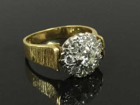 An 18ct gold diamond cluster ring, size L.