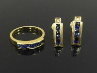 An 18ct gold sapphire ring, together with the matching earrings each set with a diamond. (3)