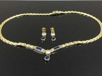 A 14ct gold necklace, together with the matching pair of earrings set with moissanite, 24.2g. (3)