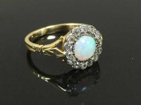 An 18ct gold antique opal and diamond cluster ring, size M.
