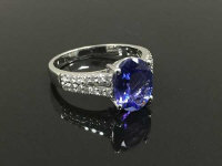 An 18ct white gold diamond and tanzanite ring, size N.