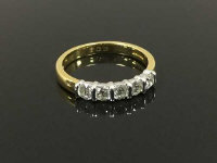 An 18ct gold five stone diamond ring, approximately 0.6ct, size M.