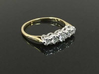 An 18ct gold five stone diamond ring, size O/P.