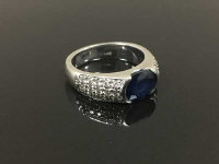 A 14ct white gold diamond and sapphire ring, size M.