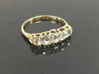 An antique 18ct gold five stone diamond ring, approximately 2cts, size P/Q.