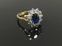An 18ct gold diamond and sapphire cluster ring, size P.