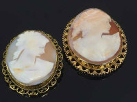 Two gold cameo brooches. (2)