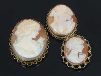 Three gold cameo brooches. (3)