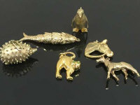 A collection of six 9ct gold animal charms, hedgehog, penguin etc, 30.9g. (6)
