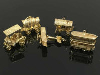 A collection of five 9ct gold charms, aeroplane, caravan, tram etc, 34.6g. (5)