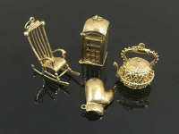 A collection of four 9ct gold charms, boxing glove, kettle, rocking chair and phone box. 26.6g. (4)