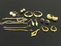 A collection of eleven pairs of gold earrings. (22)