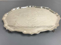 A silver tray with scalloped shaped edge, raised on short pad feet, 1233g, 40.5 cm x 31 cm, C. J. Vander Ltd, London 1970.
