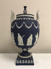 A Wedgwood Jasper Ware twin handled urn with cover, height 31 cm.