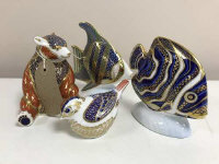 Four Royal Crown Derby animal paperweights - Koran Angel fish, seated bear, angel fish and small bird, all with gilt stoppers (4)