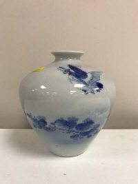 A Chinese porcelain blue and white ovoid vase, depicting a bird catching a fish, six character mark to base, height 15.5 cm
