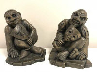 A pair of bookends, modelled as court jesters, manufactured by The Design Clinic, Cornwall, height 19.5 cm. (2)