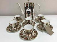 A set of six Royal Crown Derby coffee cans and saucers, and coffee pot, Imari pattern 1128.  (13)