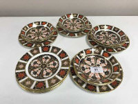 A set of eight Royal Crown Derby side plates, diameter 16 cm, together with eight further similar plates, diameter 13 cm, all Imari pattern 1128.  (16)