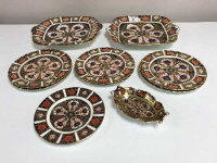 Ten pieces of Royal Crown Derby, to include a pair of square side plates, six side plates, diameter 18 cm, all pattern 1206, a small side plate and an oblong pin dish, both pattern 1128. (10)