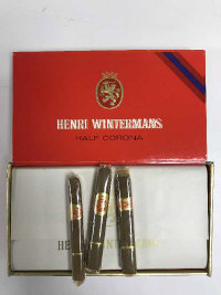A box containing a box of twenty five half Corona cigars by Henri Wintermans.