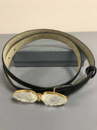 A Lalique black leather dress belt with crystal mounted buckle, in retail box with lining.