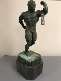 A bronze figure - Body Builder, on marble socle, height 54 cm.