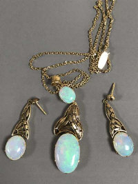 A 15ct gold opal pendant on chain together with the matching pair of earrings, 15.4g gross. (3)