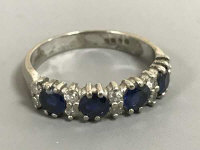 An 18ct white gold sapphire and diamond ring, size N