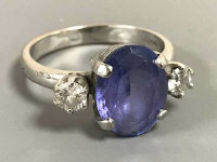 An 18ct white gold sapphire and diamond three-stone ring