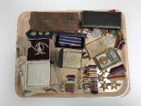A collection of mid 20th century service medals, military badges, miniature medal groups etc. (Q)
