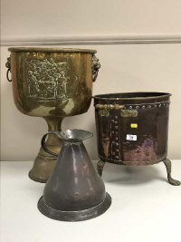 A late Victorian copper coal bucket, together with a copper flagon and a brass jardiniere. (3)