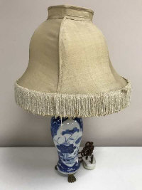 An 18th century Chinese blue and white vase, converted to a table lamp with gilt mounts, vase height 24 cm.