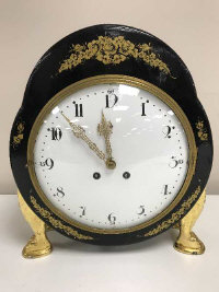 An ornate 19th century Lenzkirch lacquered and gilded time-piece, height 44 cm.