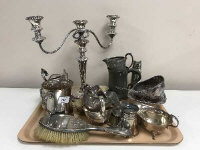 A tray of silver plated candelabrum, silver backed brushes, antique pewter tankard, metal items etc. (Q)