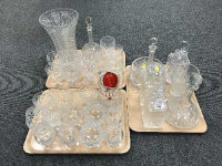A good collection of 20th century crystal to include six decanters, deep-cut crystal vase, brandy and wine glasses, ice bucket etc. (Q)
