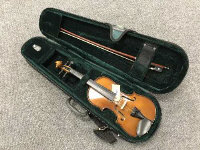 A child's violin and bow with carry case.