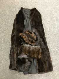 A mid twentieth century beaver fur jacket, together with a lady's fur hat, fur and black leather hand bag and a mink hat. (4)