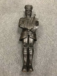 An interesting antique naively carved oak figure depicting a soldier bearing a sword and shield, height 112 cm.