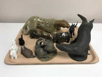 A collection of nine animal figures including a polished stone hippopotamus, otter etc.